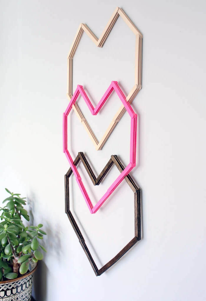 three heart intertwined, beige pink and brown, hanging on a white wall, girl room decor ideas