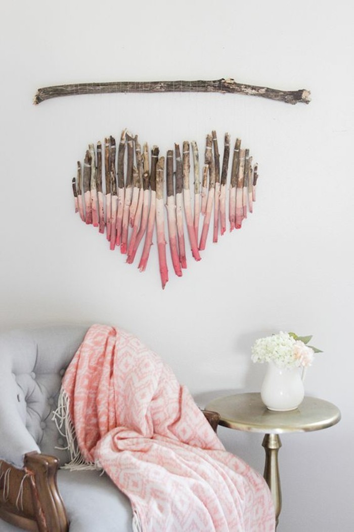 how to decorate a wall, heart shaped tree branches, painted in shades of pink, hanging on a white wall