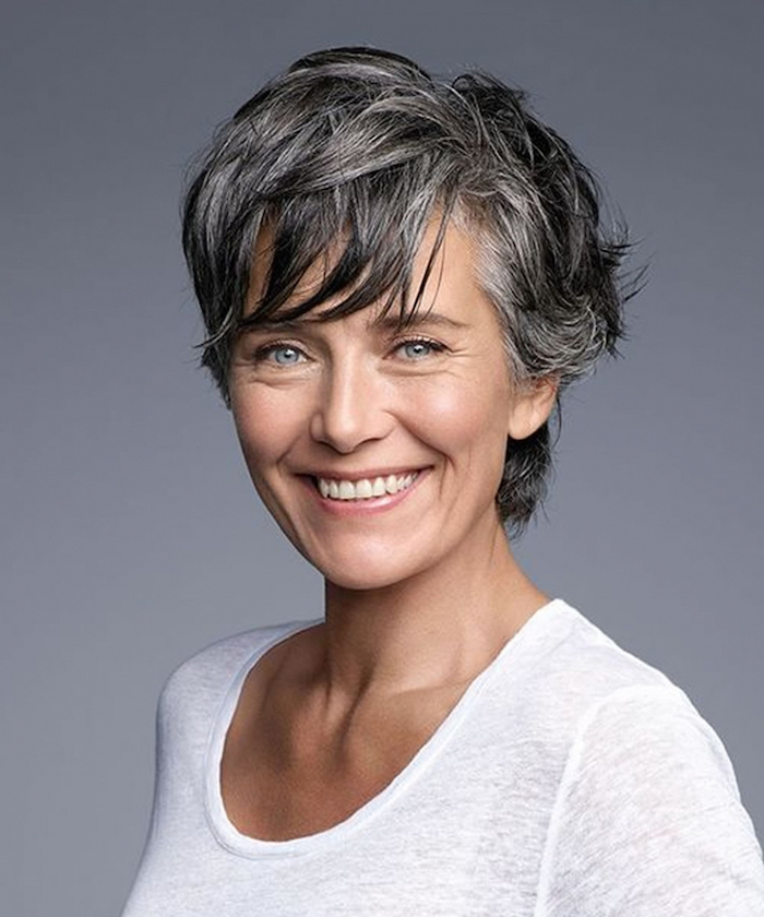 silver grey hair, short length hairstyles, white top, grey background, pixie cut
