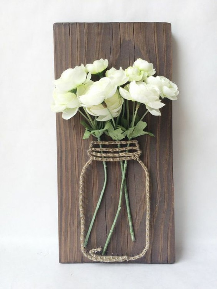 mason jar outline, made of rope and nails, bouquet of white roses, on a wooden board, large wall art ideas