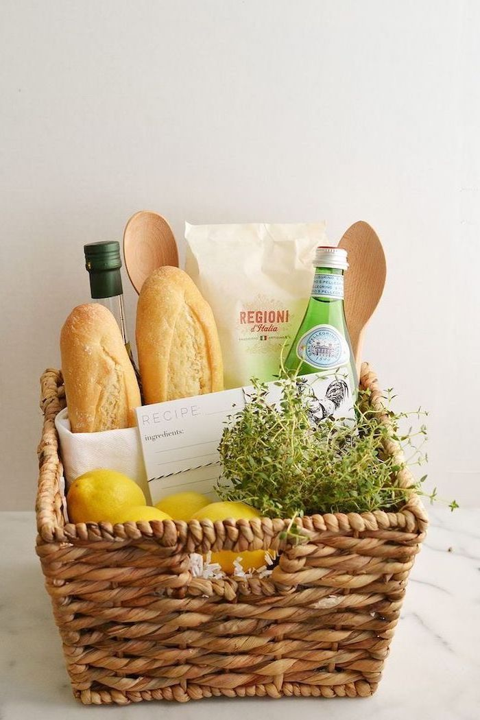wooden basket, diy gift basket, bread and lemons, pasta and spatulas, what is a good housewarming gift