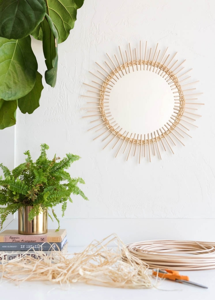 potted plants, round mirror, frame made out of wooden sticks, bedroom wall decor ideas, hanging on a white wall
