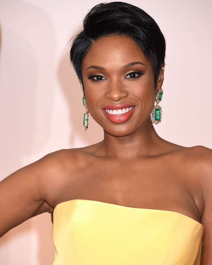 yellow dress, black hair, short wavy hairstyles, green earrings, jennifer hudson