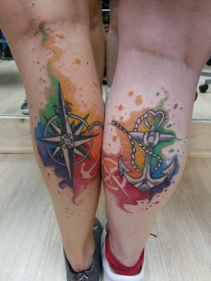 matching tattoo ideas, watercolour back of leg tattoo, anchor and compass, wooden floor