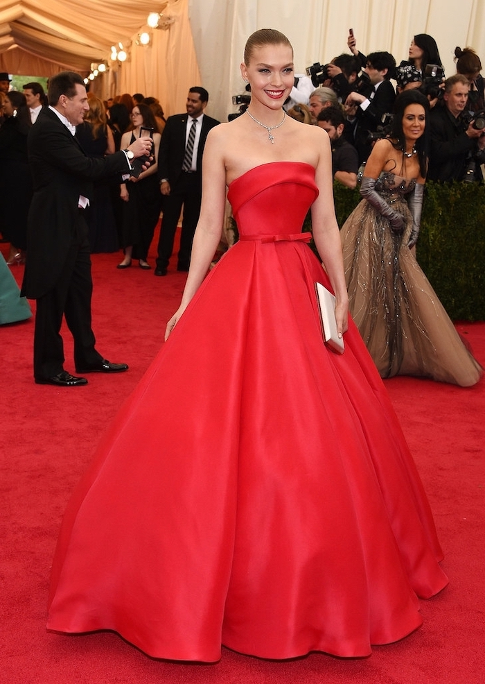 arizona muse, wearing a long red dress, strapless dress, met gala 2017 theme, crystal necklace