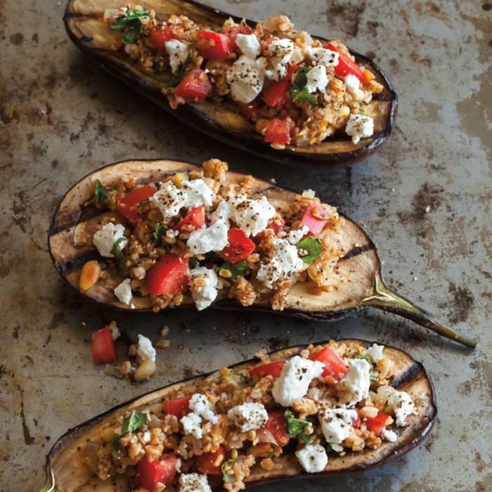 filled aubergines, cheese and chickpeas, chopped tomatoes, vegan hors d oeuvres, granite countertop