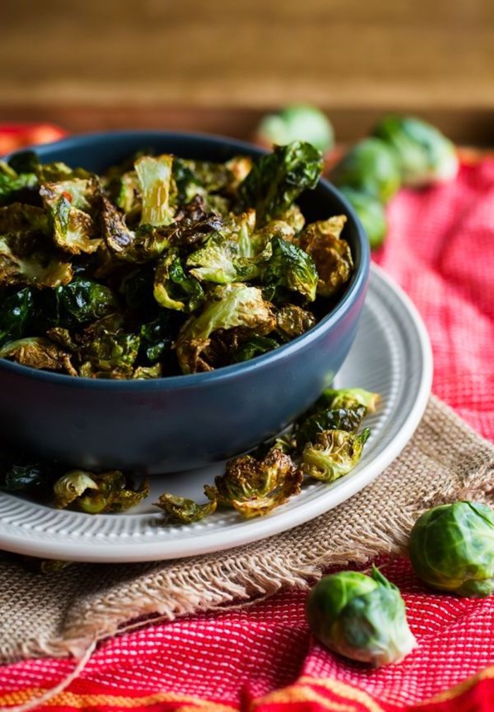 baked broccoli, inside a blue bowl, on a white plate, vegan hors d oeuvres, red and beige napkins