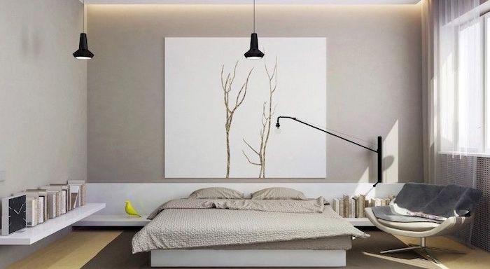 grey walls, white bed frame and shelves, bedroom ideas for women, wooden floor, leather armchair
