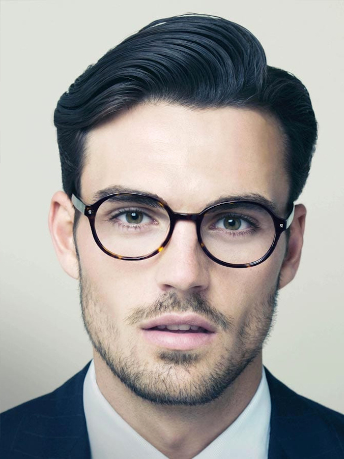 man wearing glasses, black hair, hairstyles for men, white shirt, navy jacket