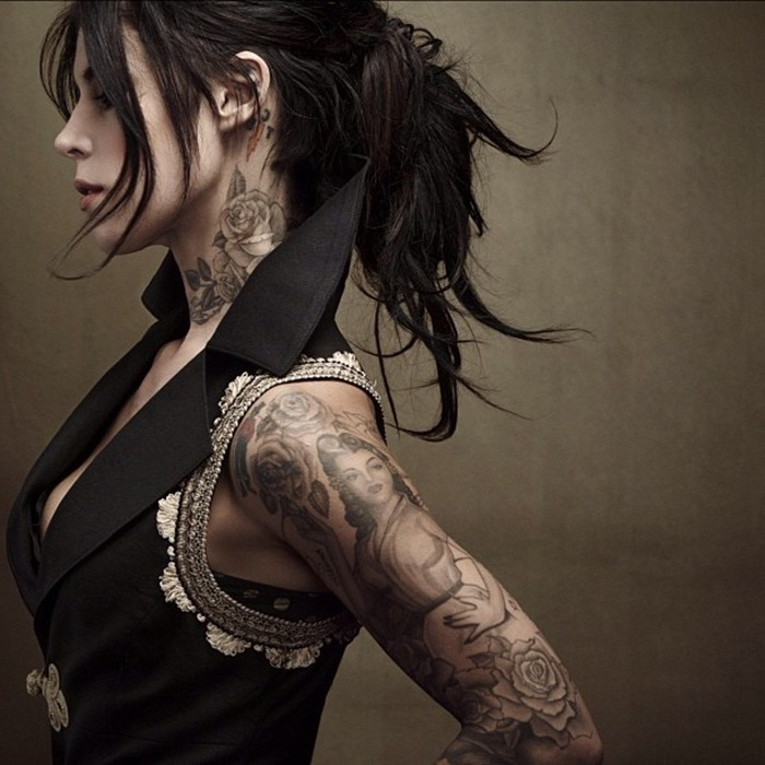 black jacket, black hair, cute tattoos for girls, rose neck tattoo, large arm sleeve tattoo