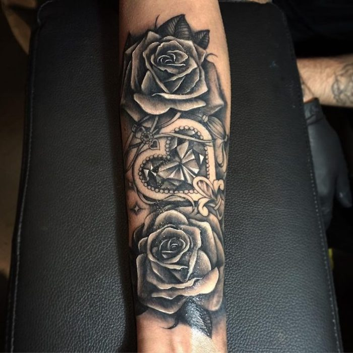 two roses, heart shaped, crystal locket, forearm tattoo, cute tattoos for girls, black leather arm rest