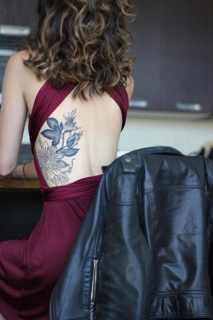 red burgundy dress, black leather jacket, floral rib cage tattoo, shoulder tattoos for girls