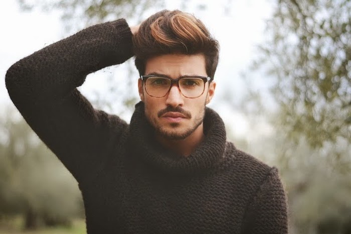 man wearing sunglasses, a black polo sweater, hairstyles for men, brown hair