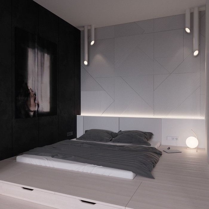 black wall, white tiled wall, wooden bed frame, abstract art, how to decorate your room