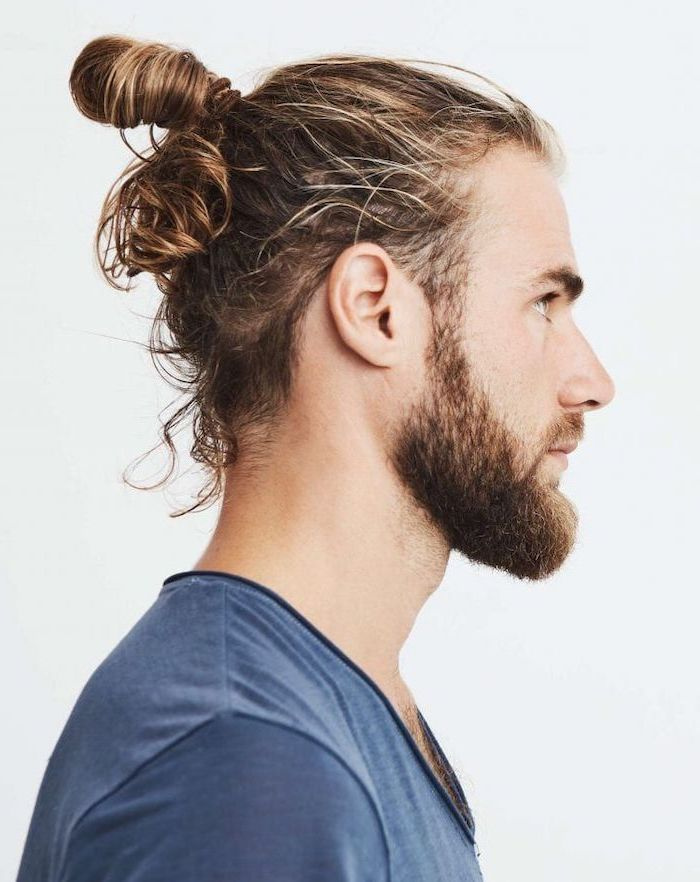medium length hairstyles for men, blonde messy hair, in a bun, blue shirt, white background