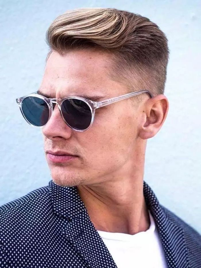 man wearing sunglasses, black jacket, white shirt, blonde hair, medium length hairstyles for men