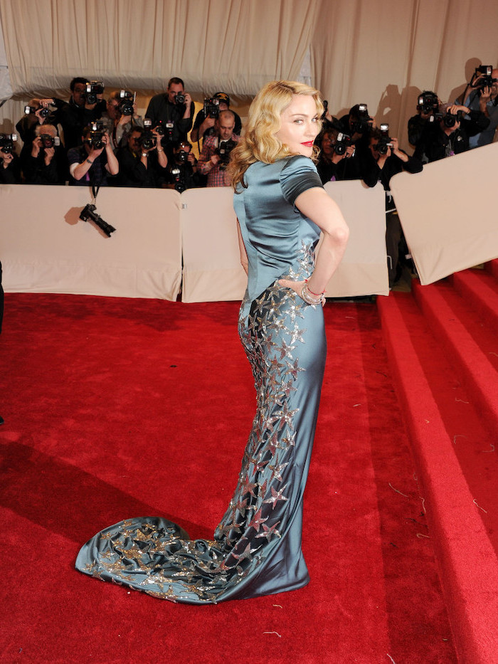 madonna on the red carpet, wearing a blue dress, with gold stars, 2017 met gala theme