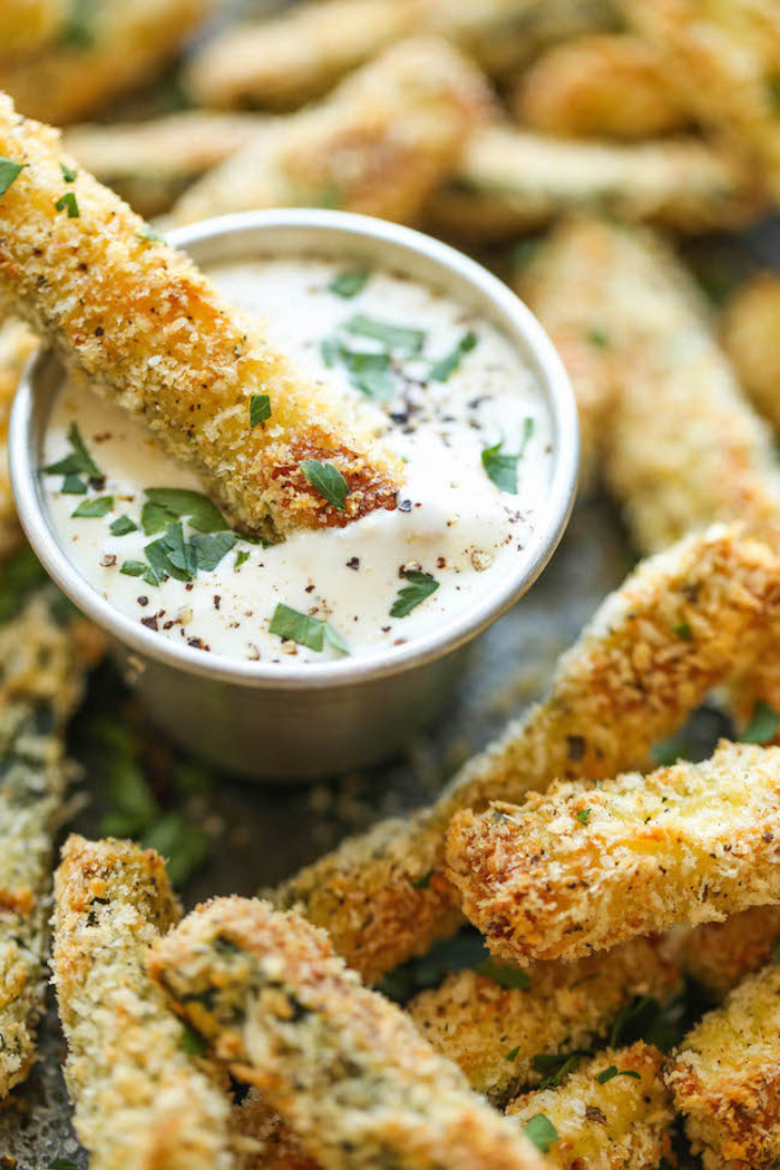 baked croquettes, sour cream and chives, in a metal bowl, dairy free appetizers
