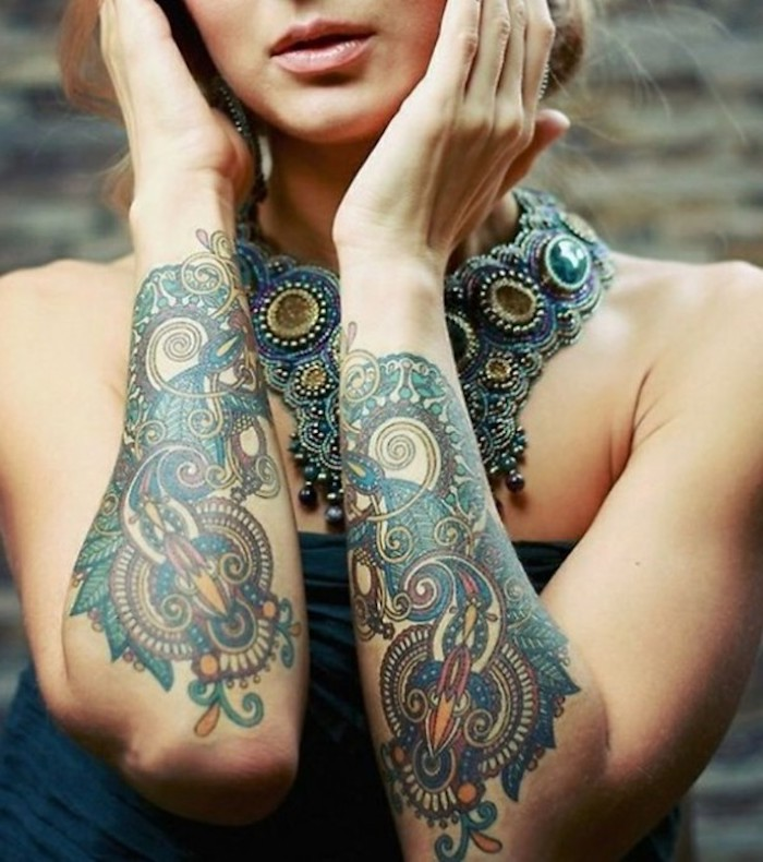 tattoo ideas for women, colourful arm tattoos, large necklace, blonde hair
