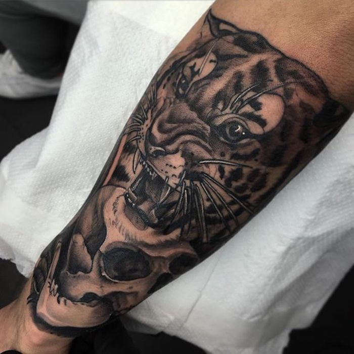 roaring tiger, skull underneath, arm tattoos for women, white paper