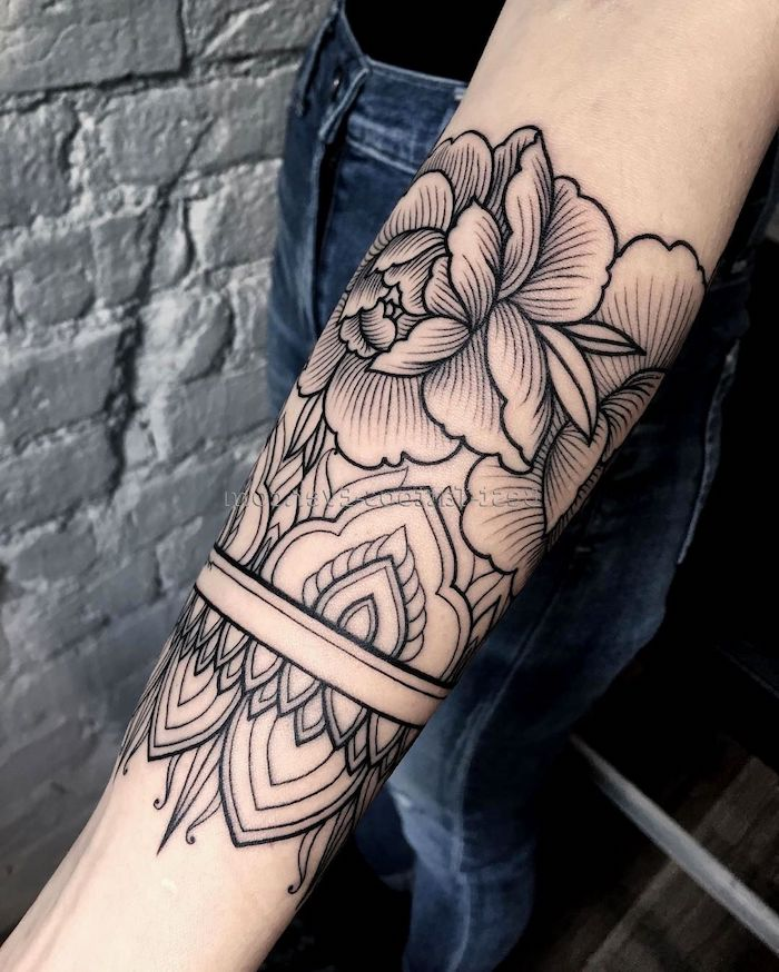 floral mandala tattoo, tattoos for men, white brick wall, blue jeans