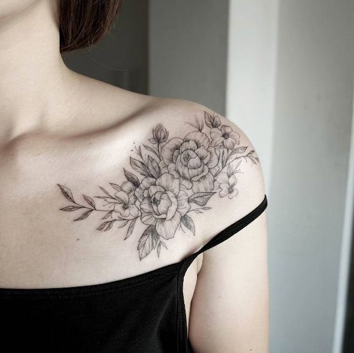 black top, small meaningful tattoos, flowers shoulder tattoo, brown hair