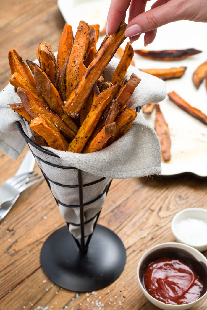 sweet potato, french fries, in a metal cone, veggie appetizers, ketchup in a white bowl