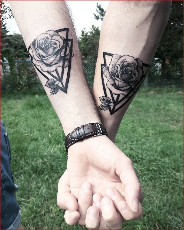geometric roses, forearm tattoos, his and hers tattoos, holding hands, green grass field