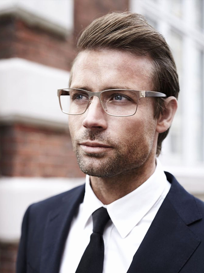 man wearing glasses, black suit, black tie, white shirt, best hairstyle for men