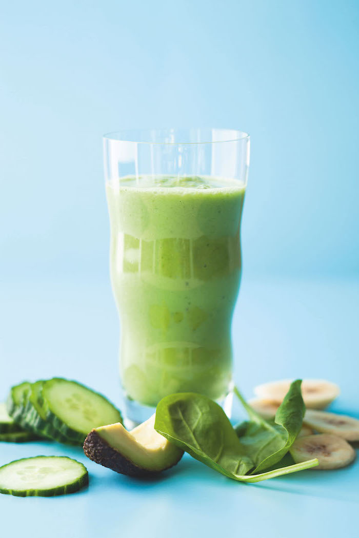 green smoothie, in a tall glass, breakfast smoothie recipes, cucumber and banana slices, avocado and spinach