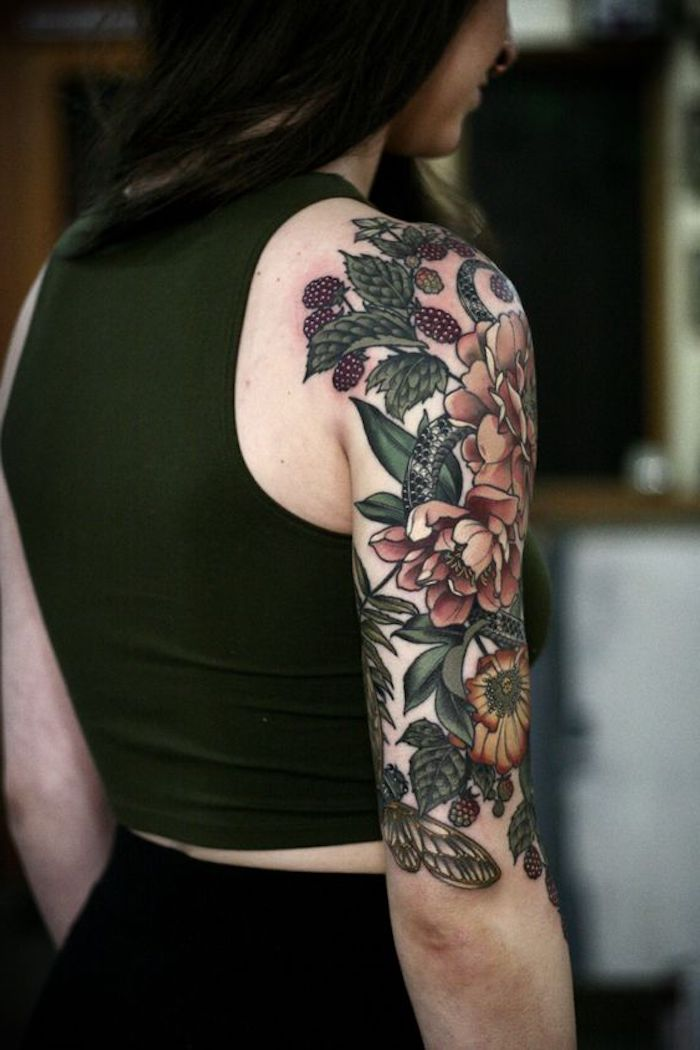 chest tattoos for females, colourful flowers, shoulder tattoo, green top, black pants