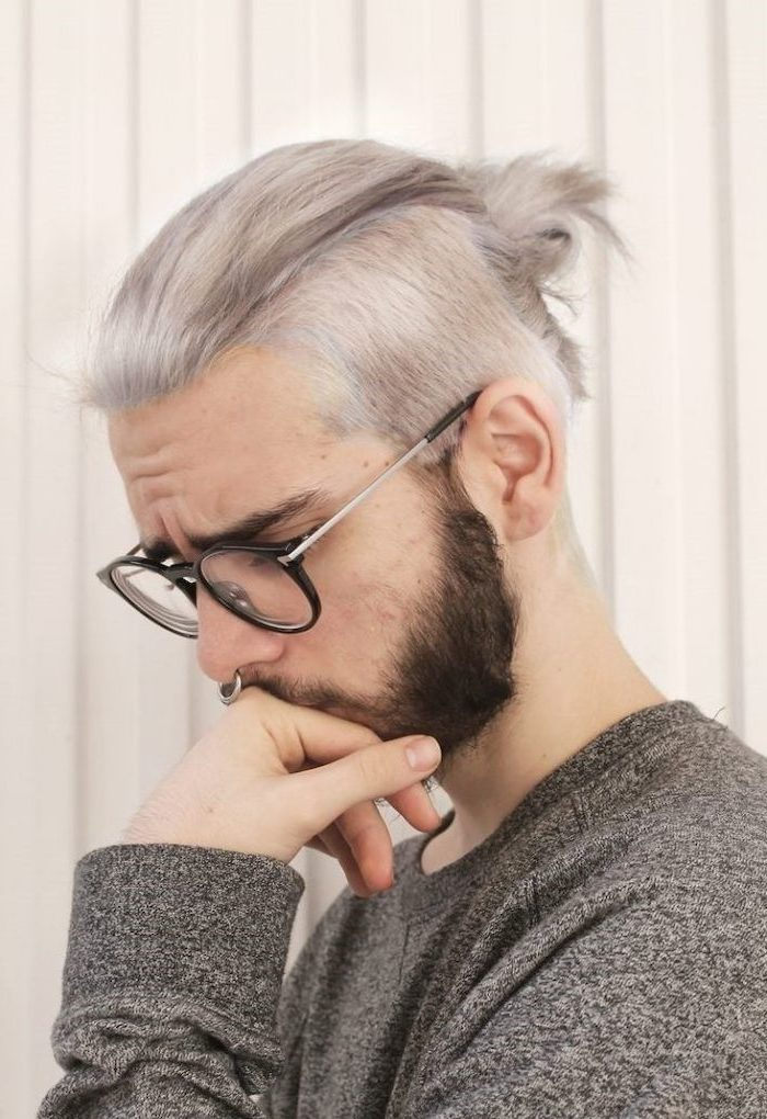 grey hair, in a bun, best hairstyle for men, man wearing glasses, grey blouse