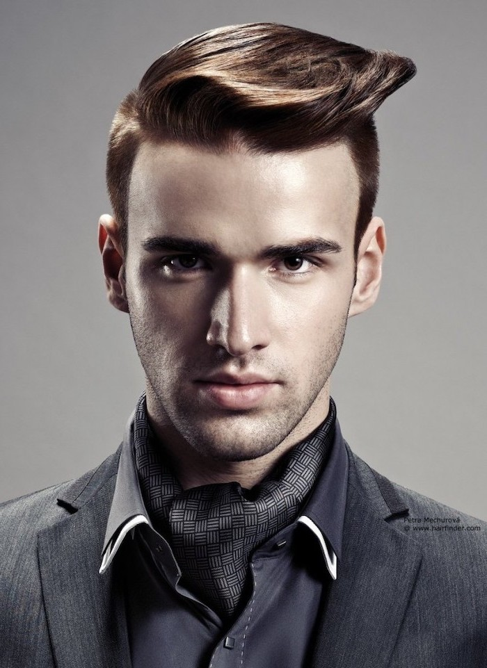 cool haircuts for men, grey jacket, navy satin shirt, brown hair, grey background
