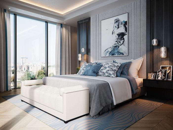 grey and blue walls and carpet, wooden floor, modern bedroom ideas, white leather ottoman