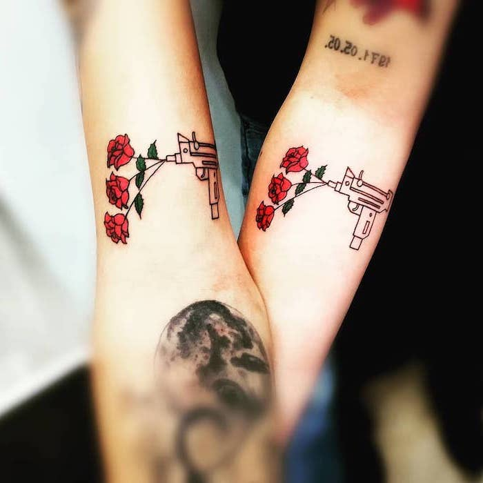 guns and roses, forearm tattoos, husband wife tattoos, blurred background