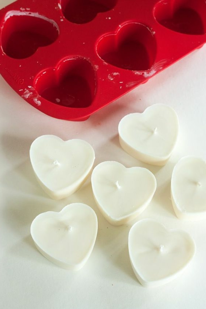 red ice tray, how to make your own candles, heart shaped candles, white countertop