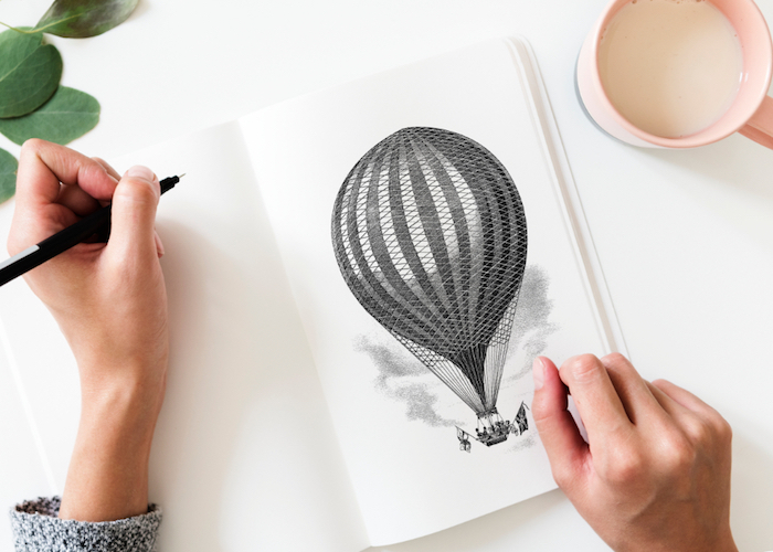 hot air balloon drawing, on a white notebook, 4k iphone wallpaper, black pencil
