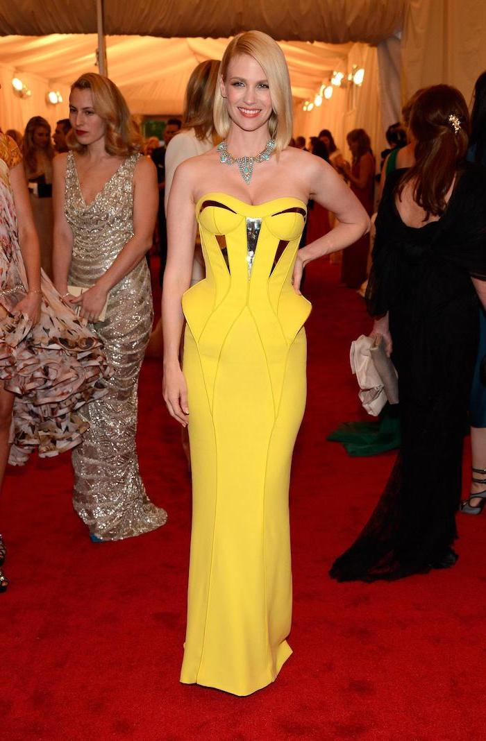 january jones, wearing a yellow strapless dress, met gala 2017, short blonde hair, crystal necklace