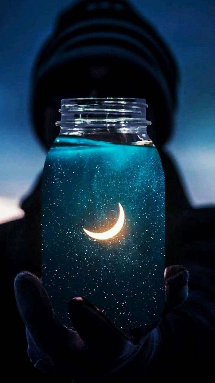 cute iphone backgrounds, person holding a jar, stars and moon inside
