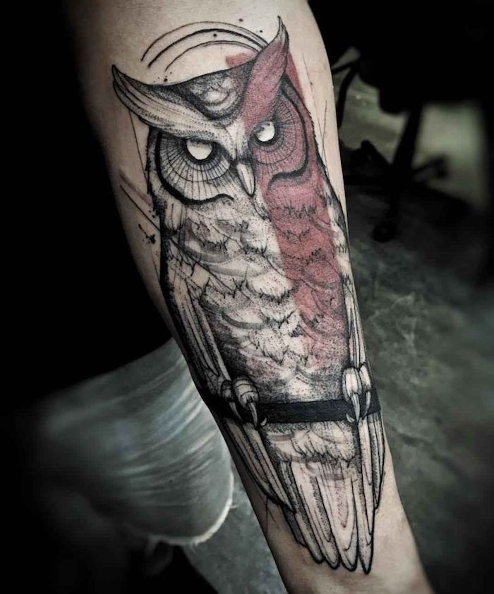 large owl, red line across it, simple tattoos for men, short jeans, black shirt