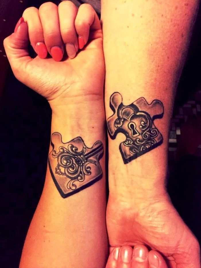 jigsaw puzzle pieces, small matching tattoos, lock and key, wrist tattoos