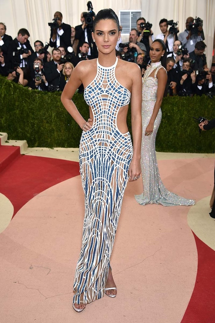 kendall jenner, wearing a long printed dress, in blue white and beige, met gala theme, silver sandals