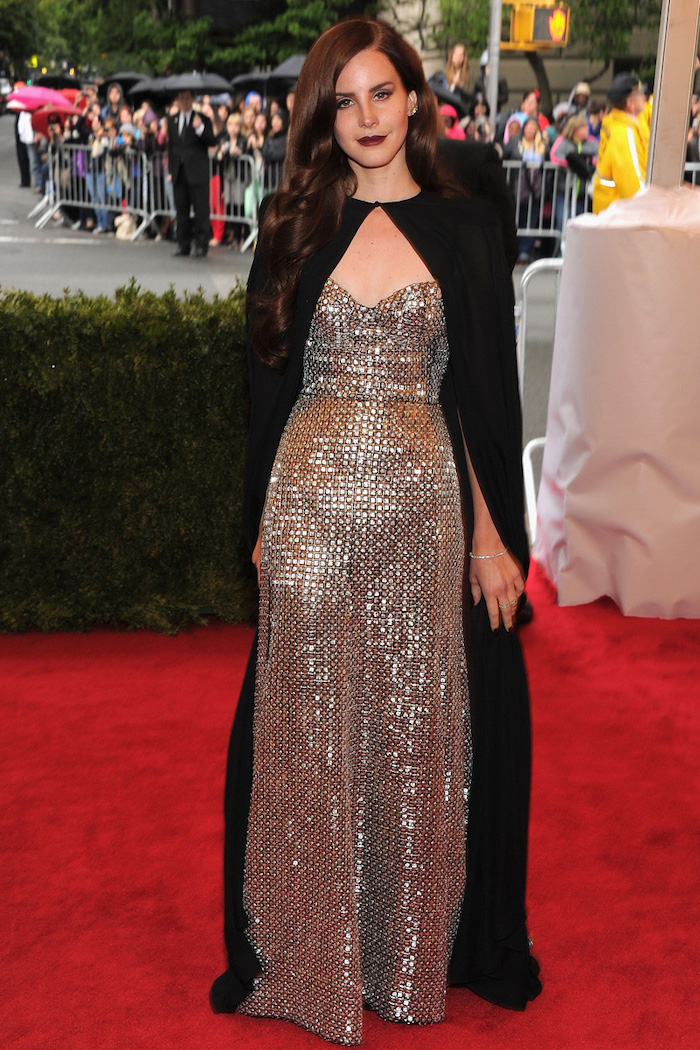 metallic dress, black cape, lana del rey, met gala 2017 date, on the red carpet, long brown hair