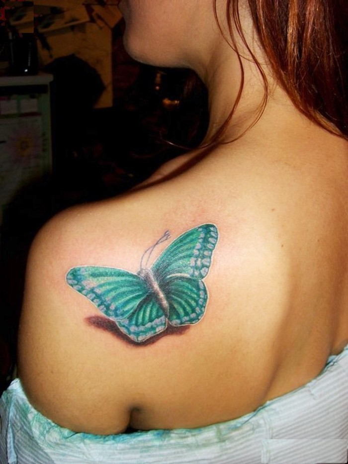 turquoise butterfly, shoulder tattoo, ginger hair, leg tattoos for women