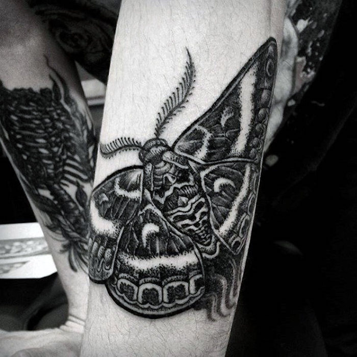 simple tattoos for men, large moth, black and white photo