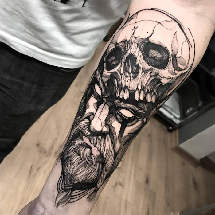tattoos for men, man's face, skull on top of it, forearm tattoo, white shirt, wooden floor