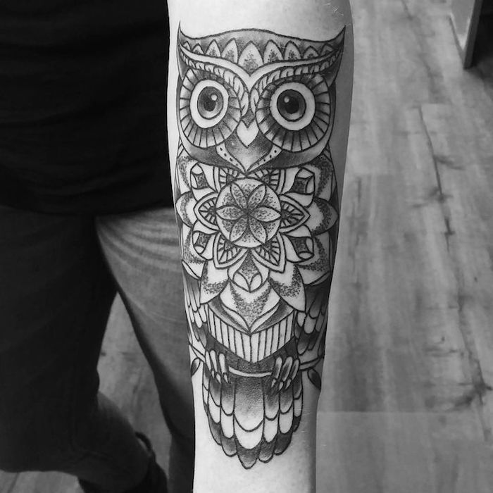 mandala owl, forearm tattoo ideas, black and white photo, wooden floor