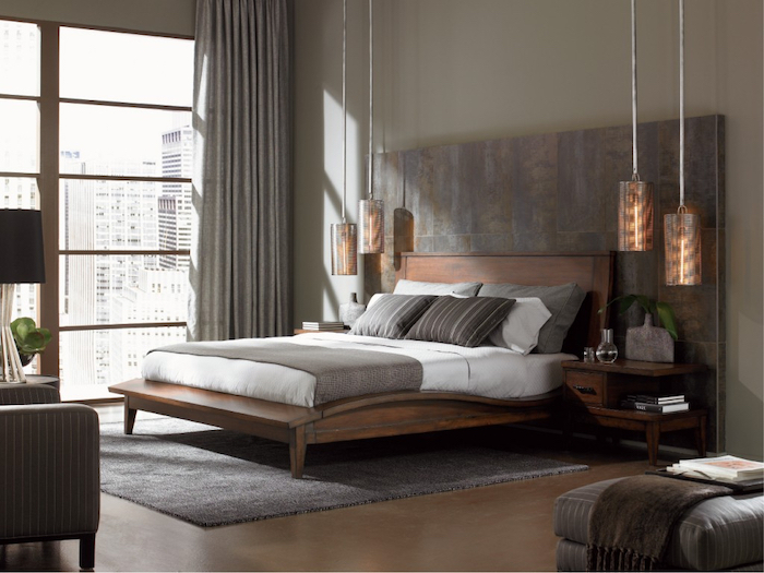 tiled accent wall, wooden bed, hanging lamps, how to decorate a bedroom, grey carpet, tall windows