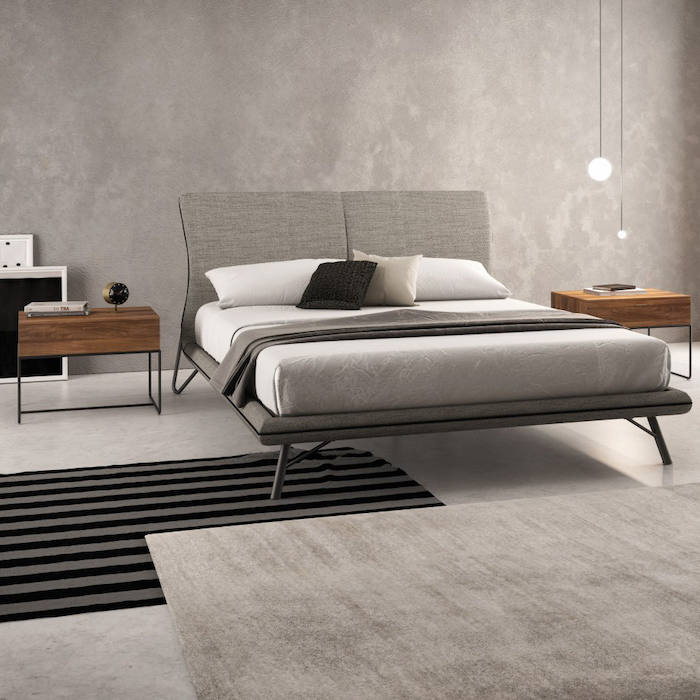 how to decorate a bedroom, grey granite walls and floor, grey bed frame, wooden night stands