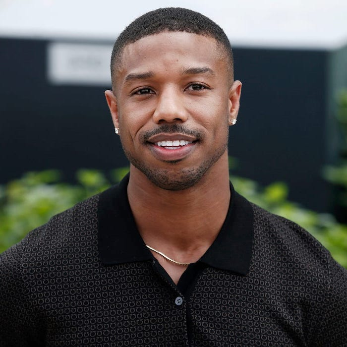 michael b jordan, wearing a black shirt, short black hair, two earrings, hairstyles for men